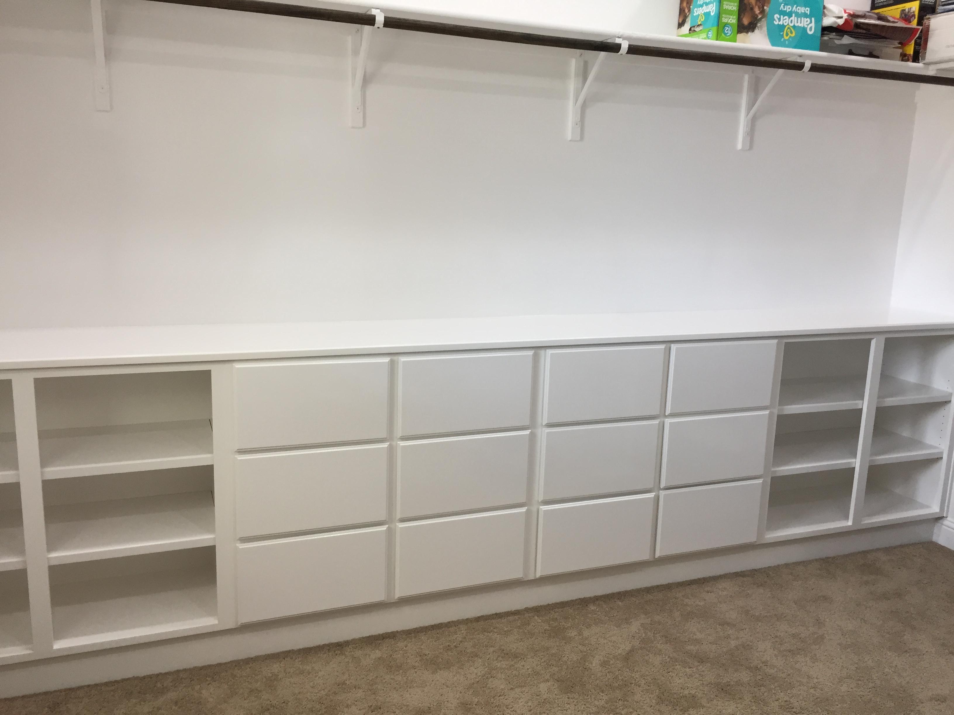 Photo of White Closet Storage With Shoe Shelves